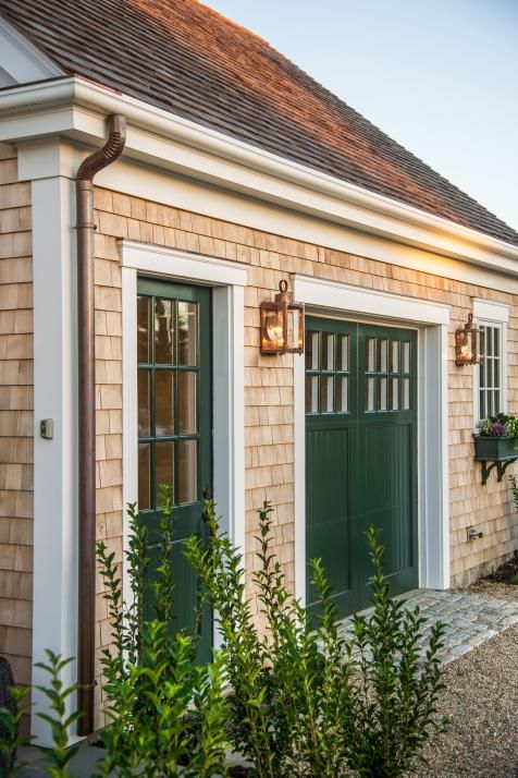 Old Fashioned Lanterns Emit Soft Inviting Light And Adorn Each Side Of The Carriage Garage Door For An Added Touch Elegance In Evening