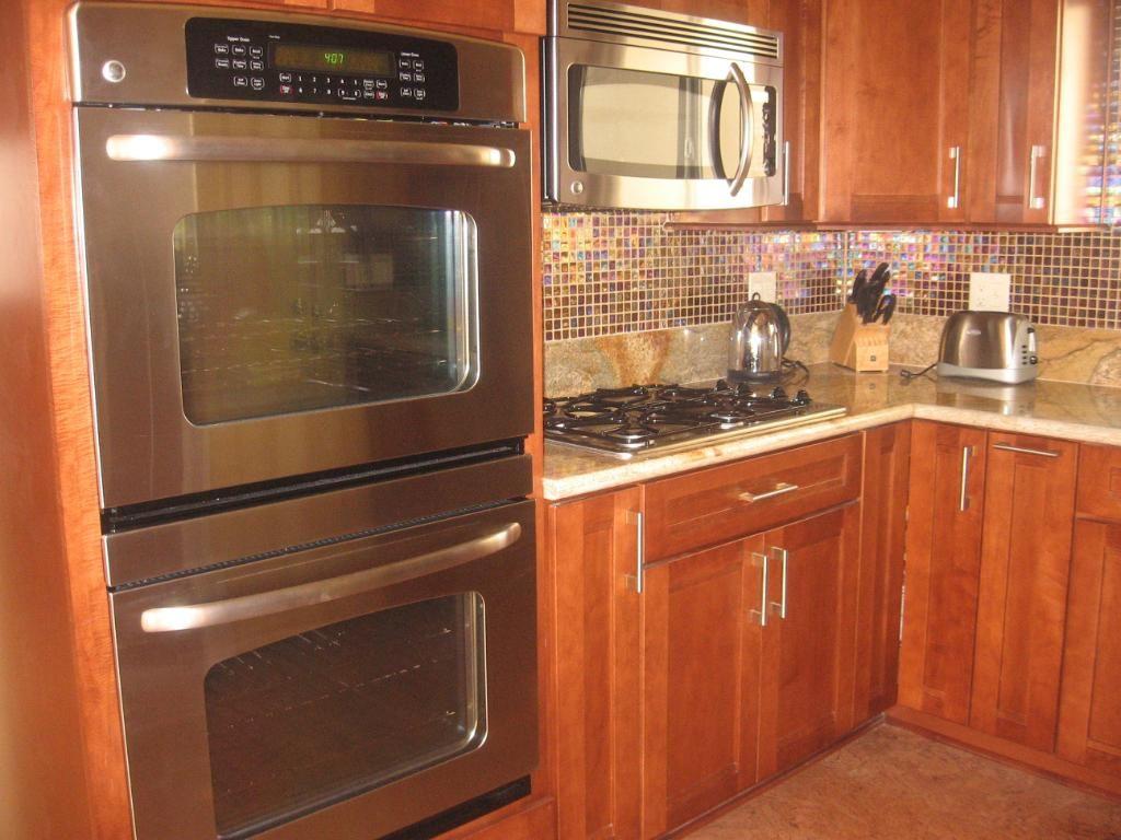 cork floor... double oven... pretty back splash Double