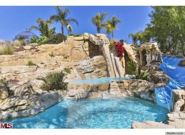 Malibu Home With Free Form Rock Pool And Twisty Slide.