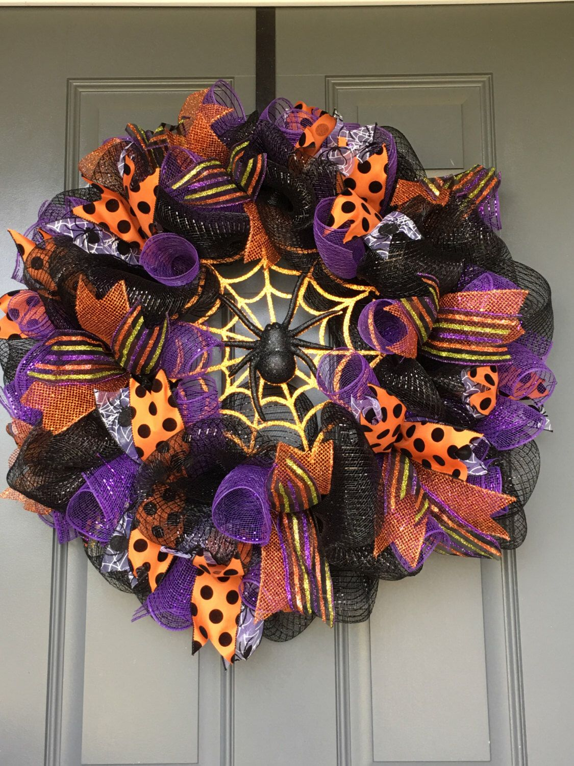 A personal favorite from my Etsy shop https://www.etsy.com/listing/479681739/halloween-wreath-spider-web-deco-mesh