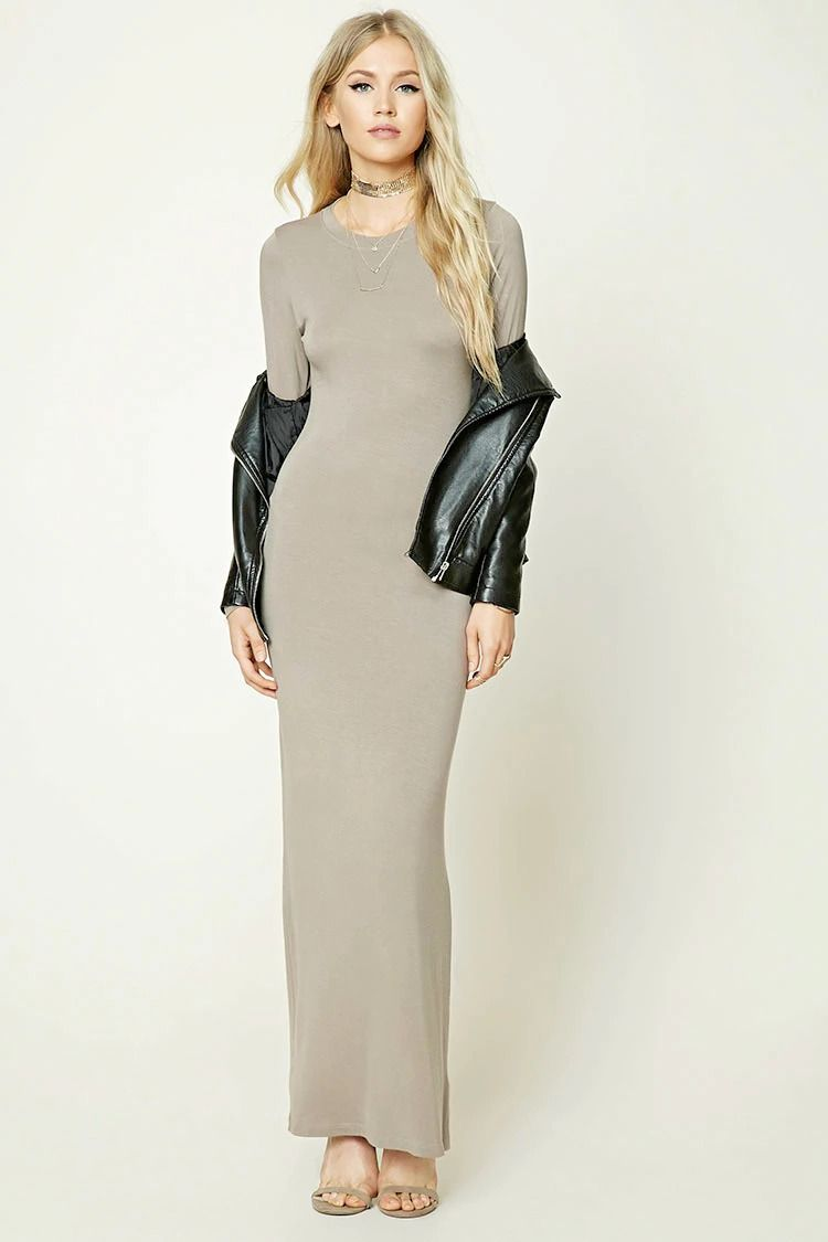 A knit maxi dress featuring a bodycon silhouette crew neckline and