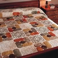 If you love the interlaced scrollwork of celtic designs, this quilt is for you.  techniques for preparing bias strips are in Sew Easy: 90 x 114. PAttern free from download at Fons & Porter.
