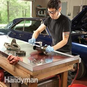 """Add a metal cover to your existing workbench. The """"Always Clean"""" workbench. http://www.familyhandyman.com/workshop/upgrading-your-garage-workshop/view-all#step1"""