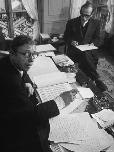Playwright Jean Paul Sartre at His Desk as Artist Saul Steinberg Sketches at Sartre's Home in ParisBy Gjon Mili #jeanpaulsartre