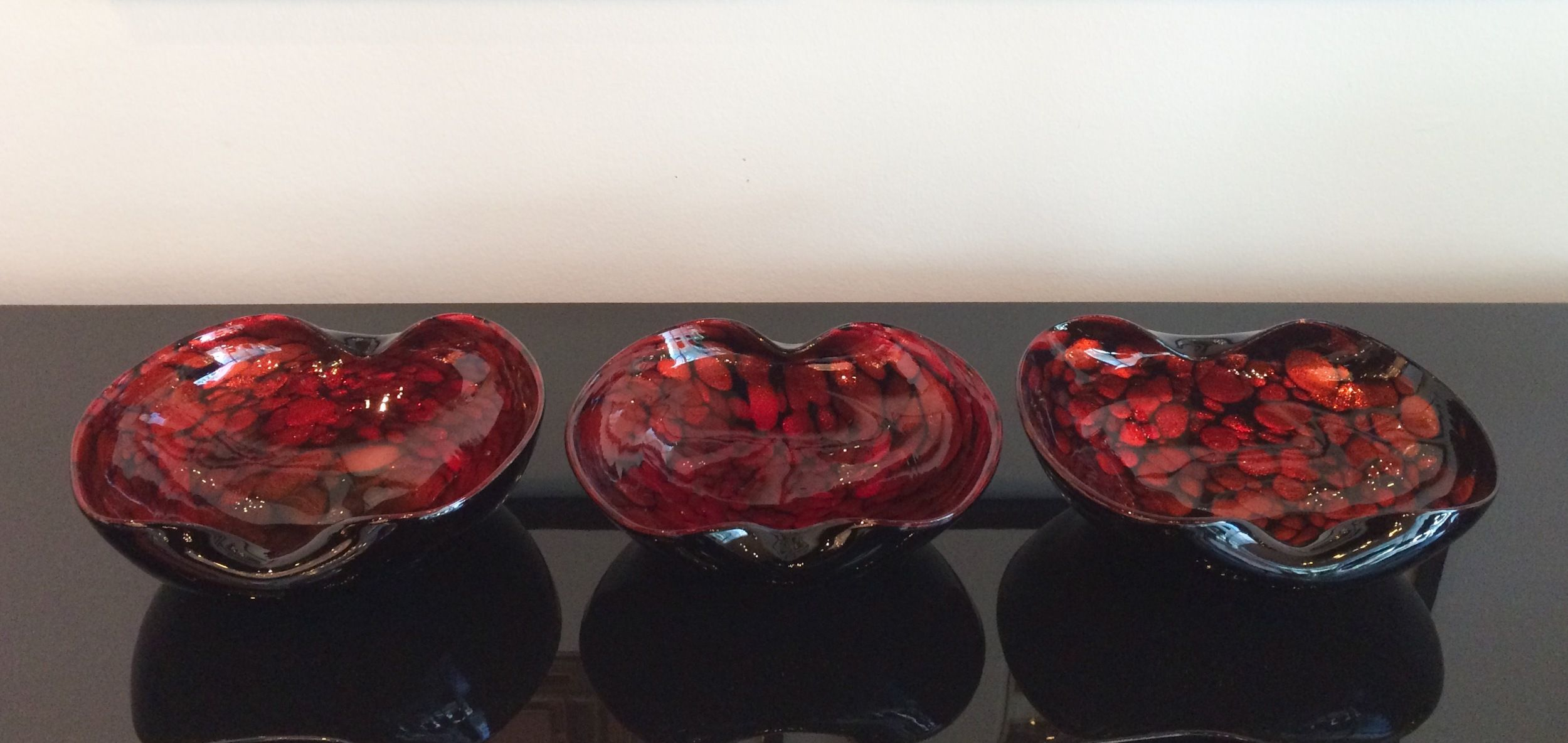 SOLD   Set of 3 Murano bowls; cased clear, black and red orange w/heavy aventurine inclusions; ca. 1950