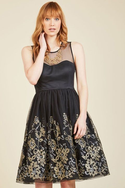 0eadfb3b2e51 Magnificent Details: All of the pretty details in this fit and flare dress  like the illusion neckline and the metallic gold floral pattern are what  make it ...
