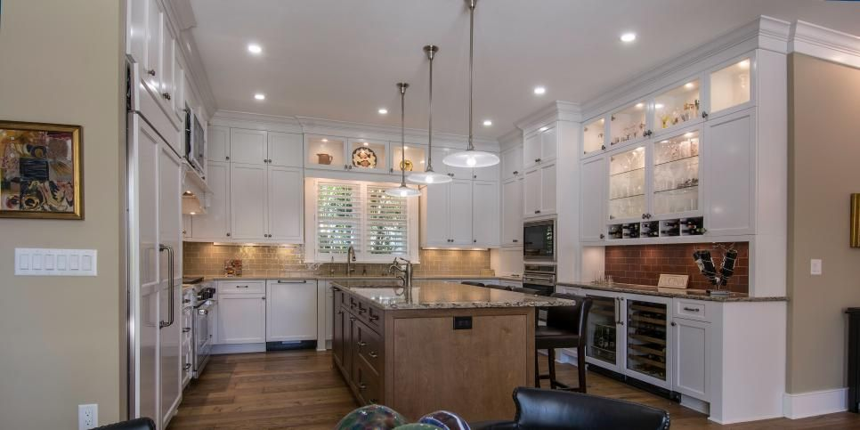 A large galley kitchen makes a stunning statement in this classic ...
