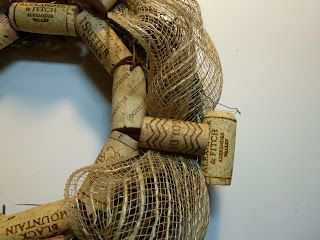 Photo of Recycled wine cork and burlap ribbon wreath
