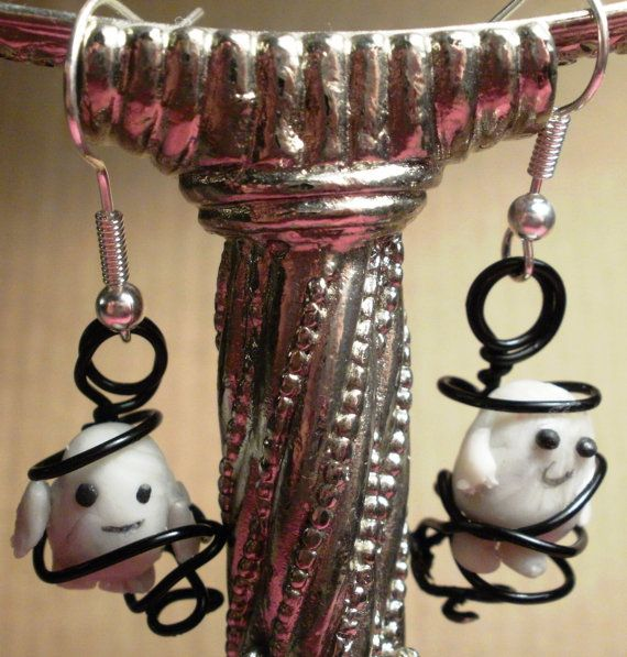 adipose baby earrings. i like how their all tangled up in the wire, would be a cute idea with any figurine