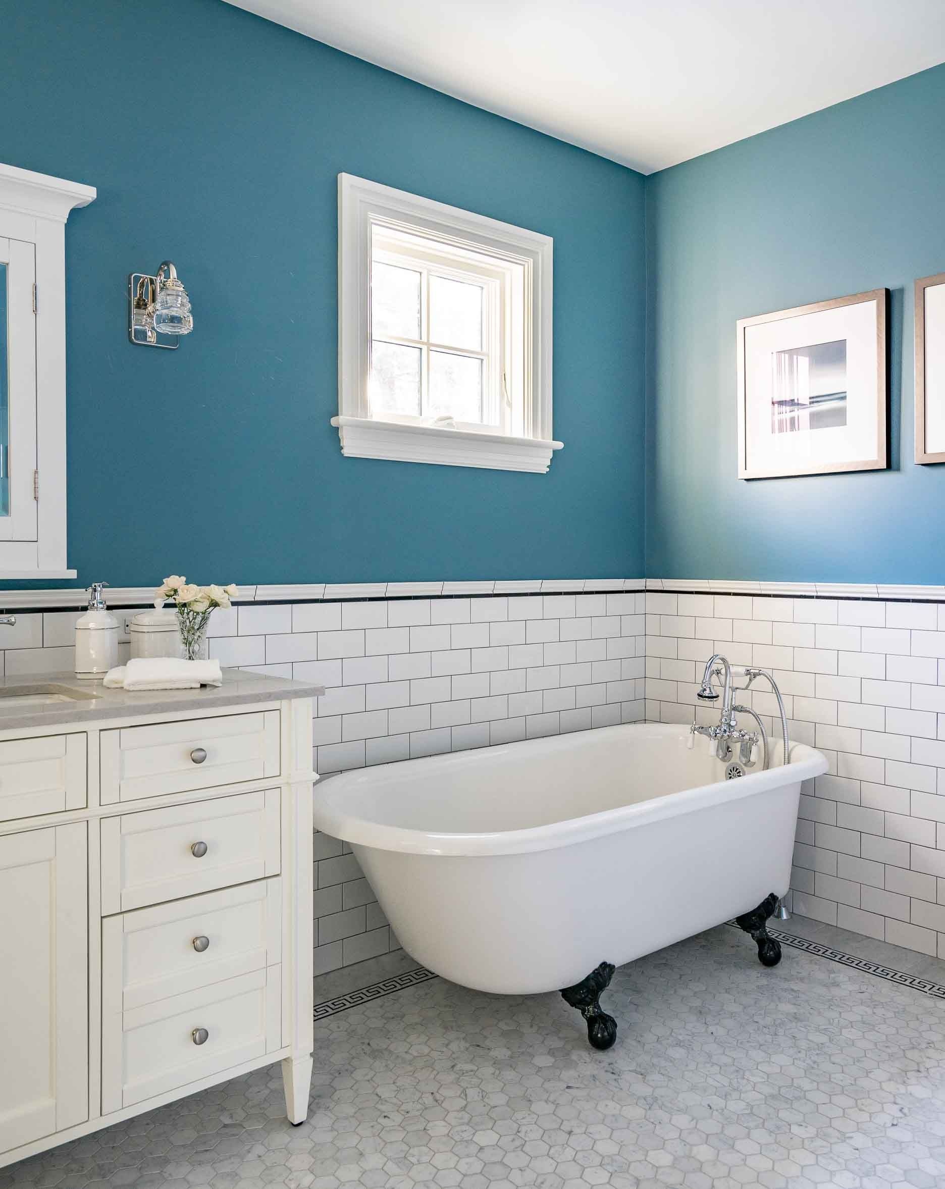 Master bath addition showcases an antique clawfoot tub and white ...