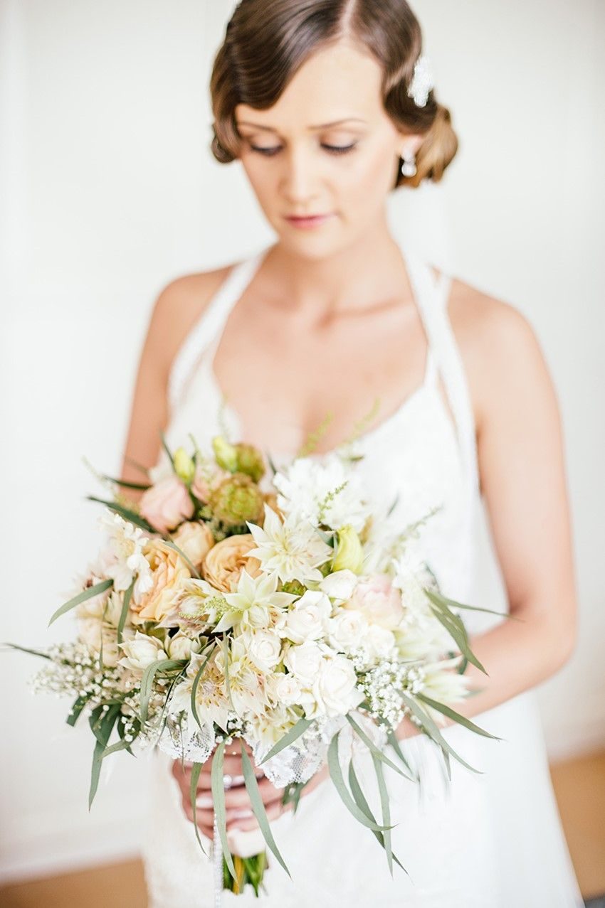 A beautiful s inspired wedding with a barn reception bouquet