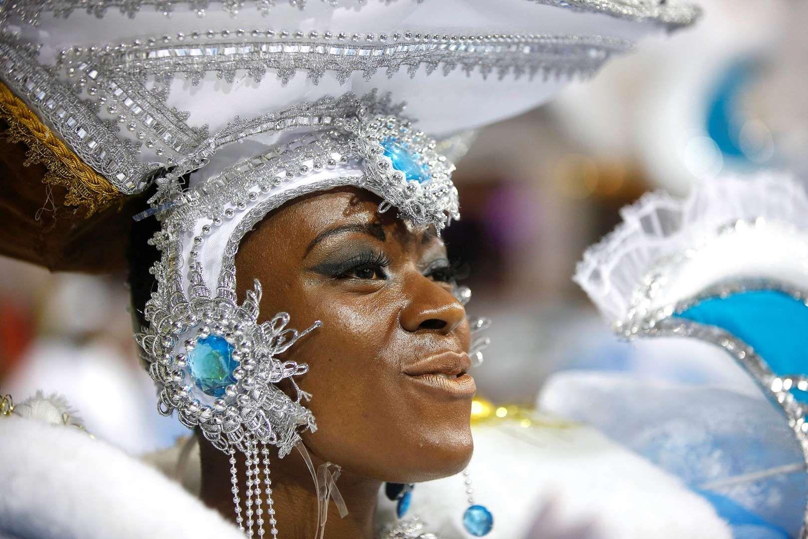 A dancer from the Nene de Vila Matilde samba school performs during a carnival parade in Sao Paulo, Brazil