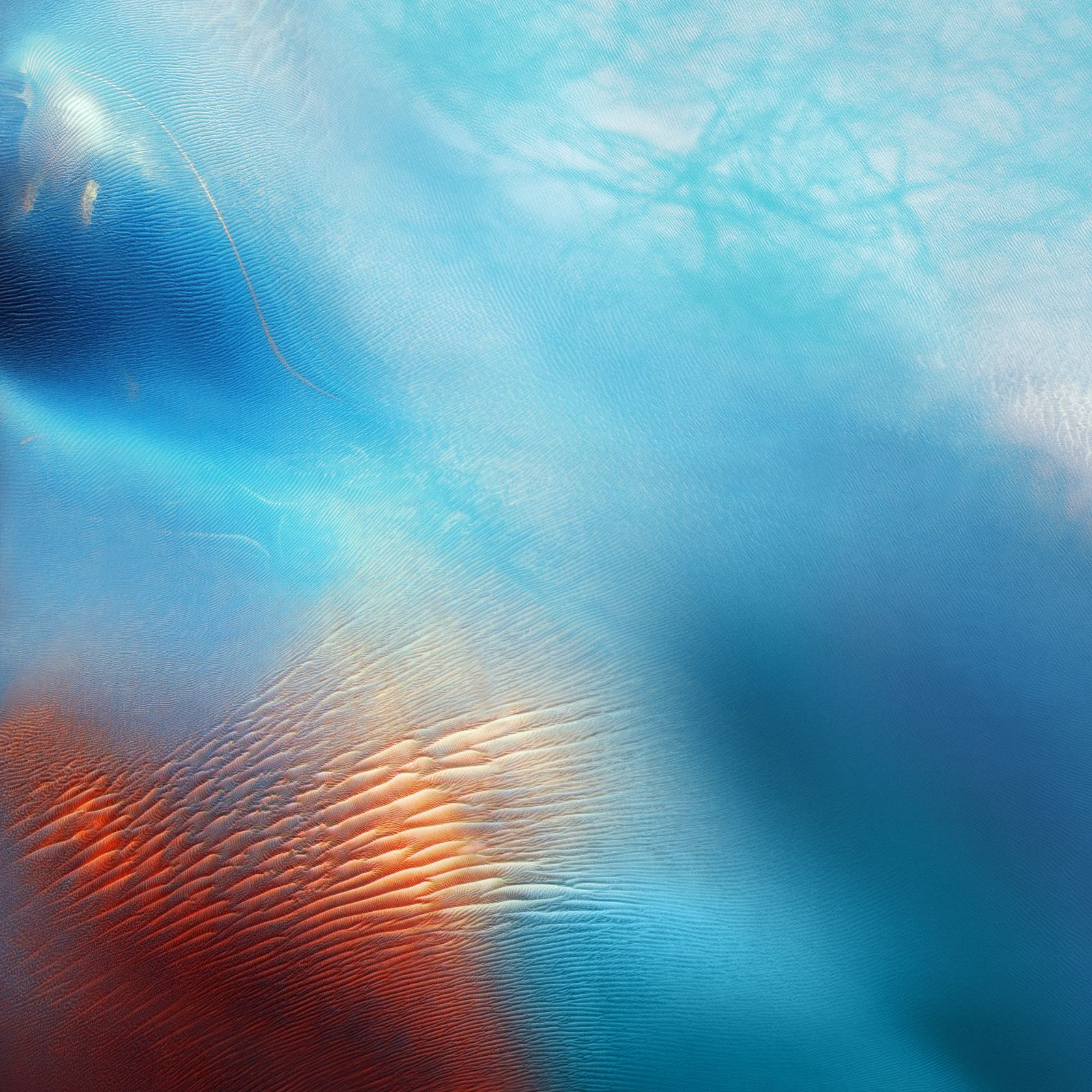 iOS 9 had a new resolution for the default wallpapers (on