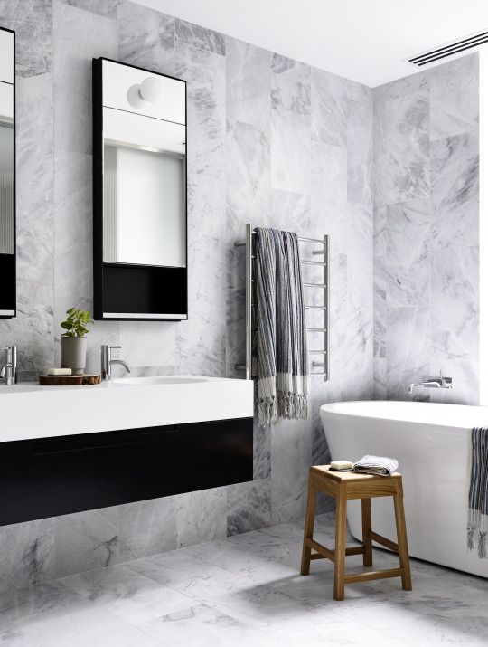 rectangular marble tiles in a random pattern black and white tb
