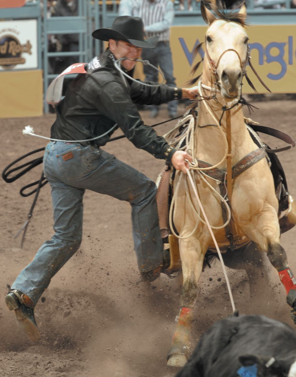 Rodeo with man wearing jeans, cowboy boots, and a cowboy hat ...