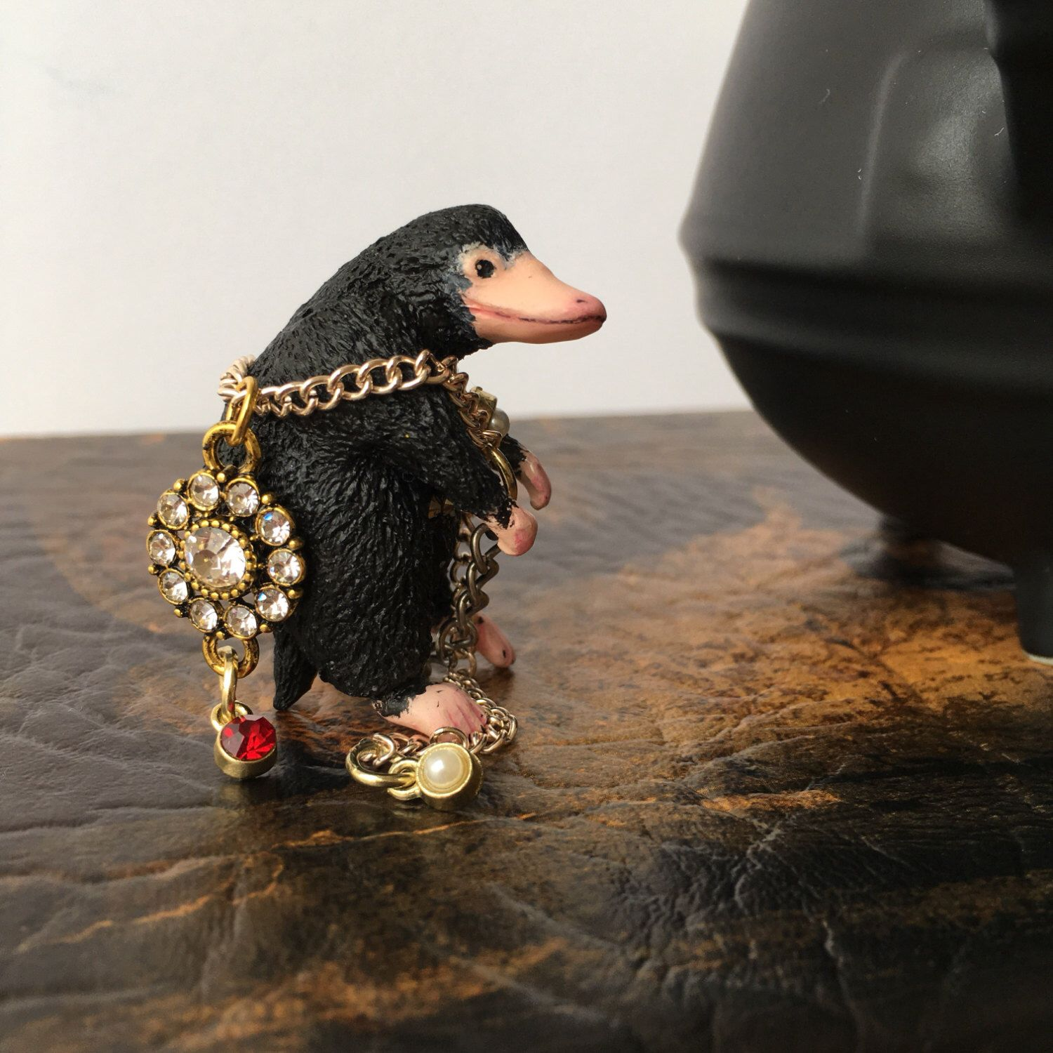 A personal favorite from my Etsy shop https://www.etsy.com/listing/505527255/naughty-niffler-tea-infuser-fantastic