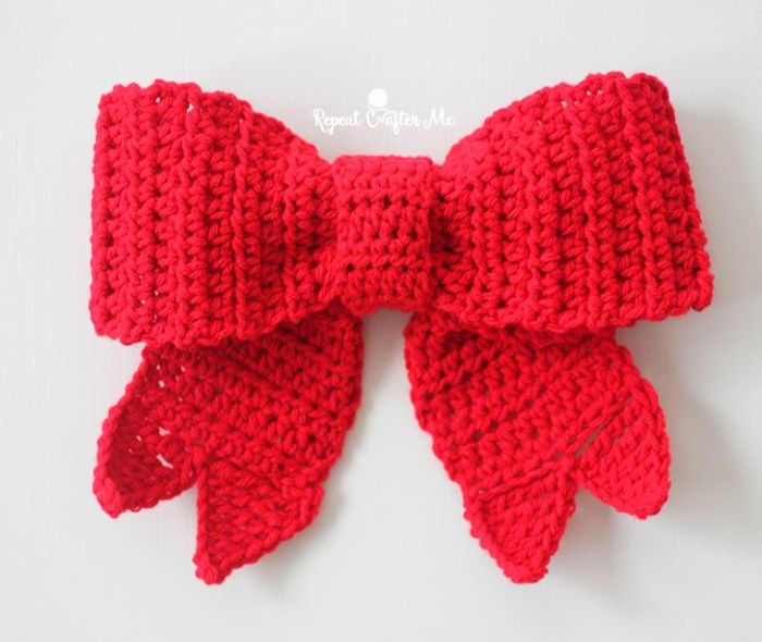 Big Red Bows make festive decor during the holiday season and now you can crochet one! Hang it on your door, wreath, tree, packages, and more! I've written out a simple pattern but included a little video tutorial to show a few of the steps that might be confusing (like the standing stitches and how …