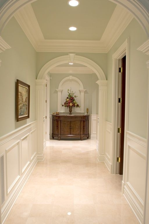 Traditional Hallway With Sandstone Tile Floors American