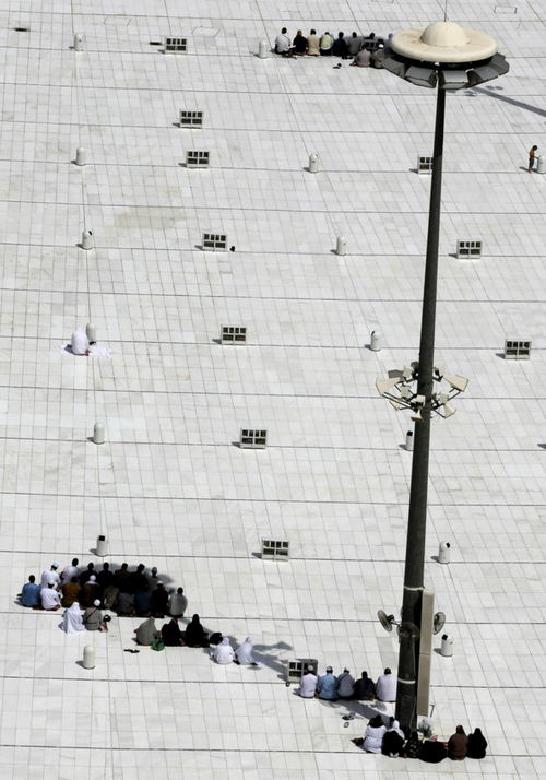 Muslim pilgrims in Mecca, Saudi Arabia, prayed on top of the Grand Mosque, the focal point of the Islamic faith.  Picture:Hassan Ammar/AP