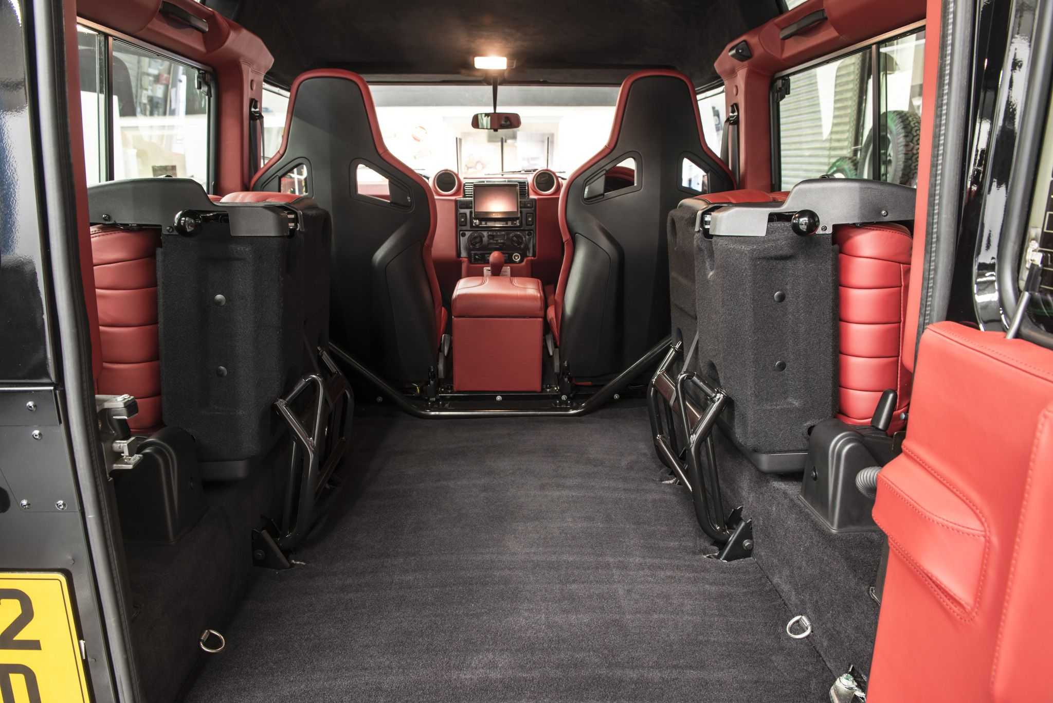 Twisted red edition interior from the rear short and long for Interior land rover defender
