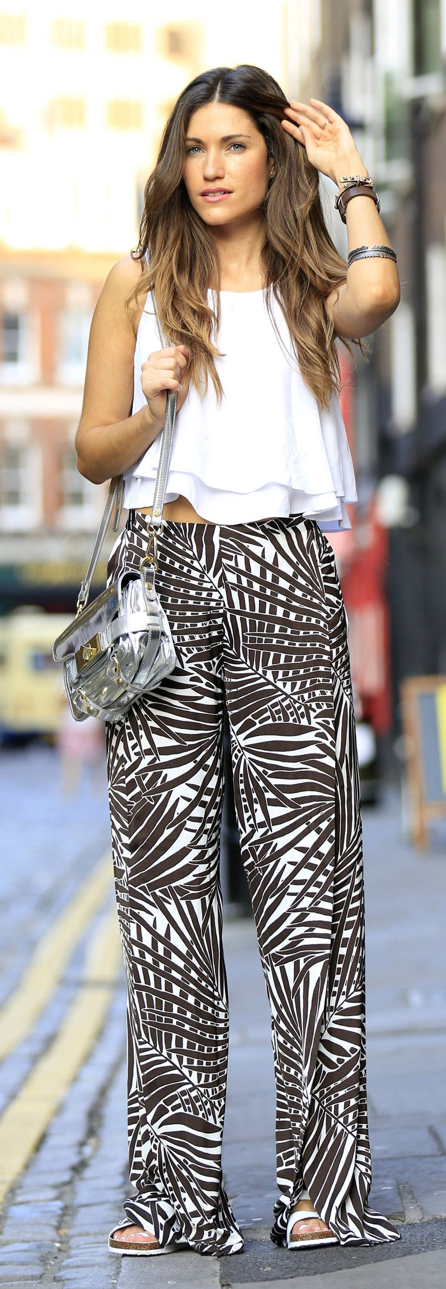Ariana Chiche is wearing a top and shoes from Zara and the tropical print palazzo trousers are from TopShop