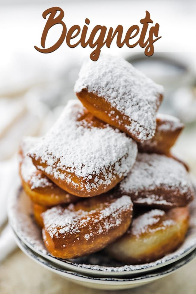The Best Authentic New Orleans Beignets Recipe - These delicious easy to make light and fluffy fried beignets covered in powdered sugar will make you feel like your right at Café du Monde in New Orleans. #beignets #neworleans #beignetrecipe #donuts #doughnuts