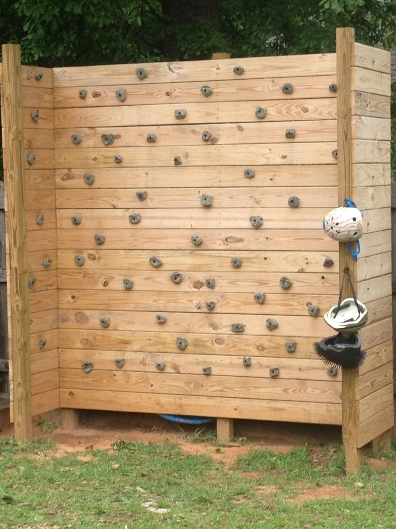Climbing Wall Made With Pressure Treated Deck Boards 12 Foot 4x4 Posts And Climbing Holds Ordered From Ama Rock Climbing Wall Backyard For Kids Climbing Wall