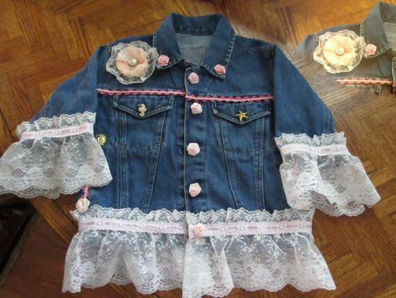Girls Denim jacket embellished with ribbon inserted lace and pink rose buds. Pink satin back with button flowers and butterfly applique.