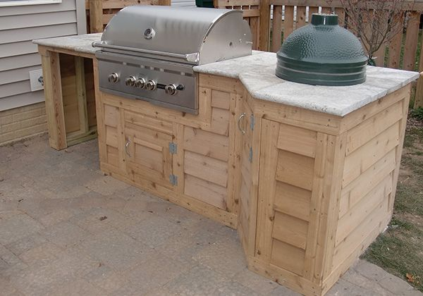 Outdoor kitchens spellacy 39 s turf lawn inc outdoors for Cedar outdoor kitchen cabinets