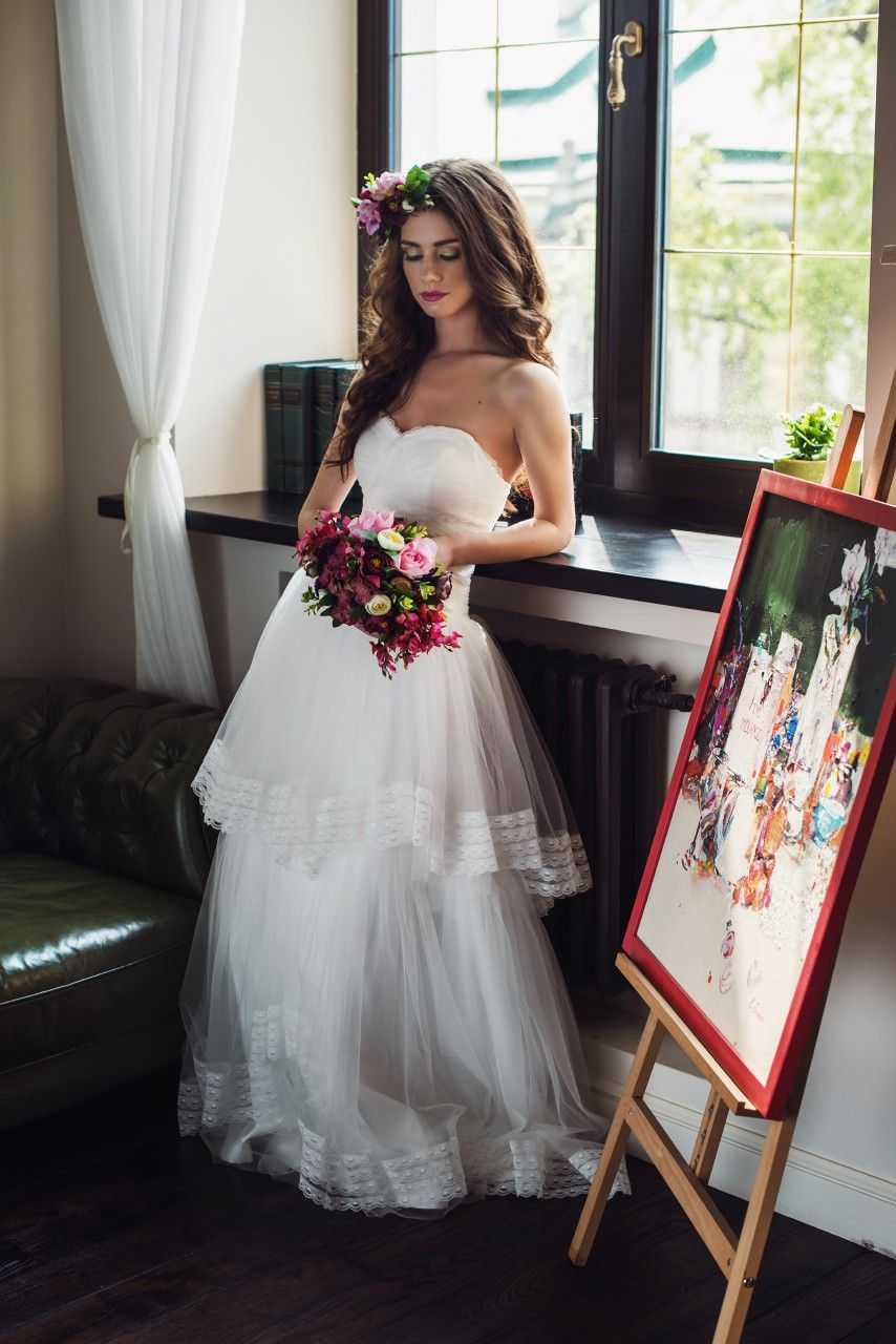 """Onovian Vilage"" This lovely dress features a soft layered tulle skirt which accents the sweetheart top perfectly, giving it a light and feminine edge to an otherwise classic gown. None"