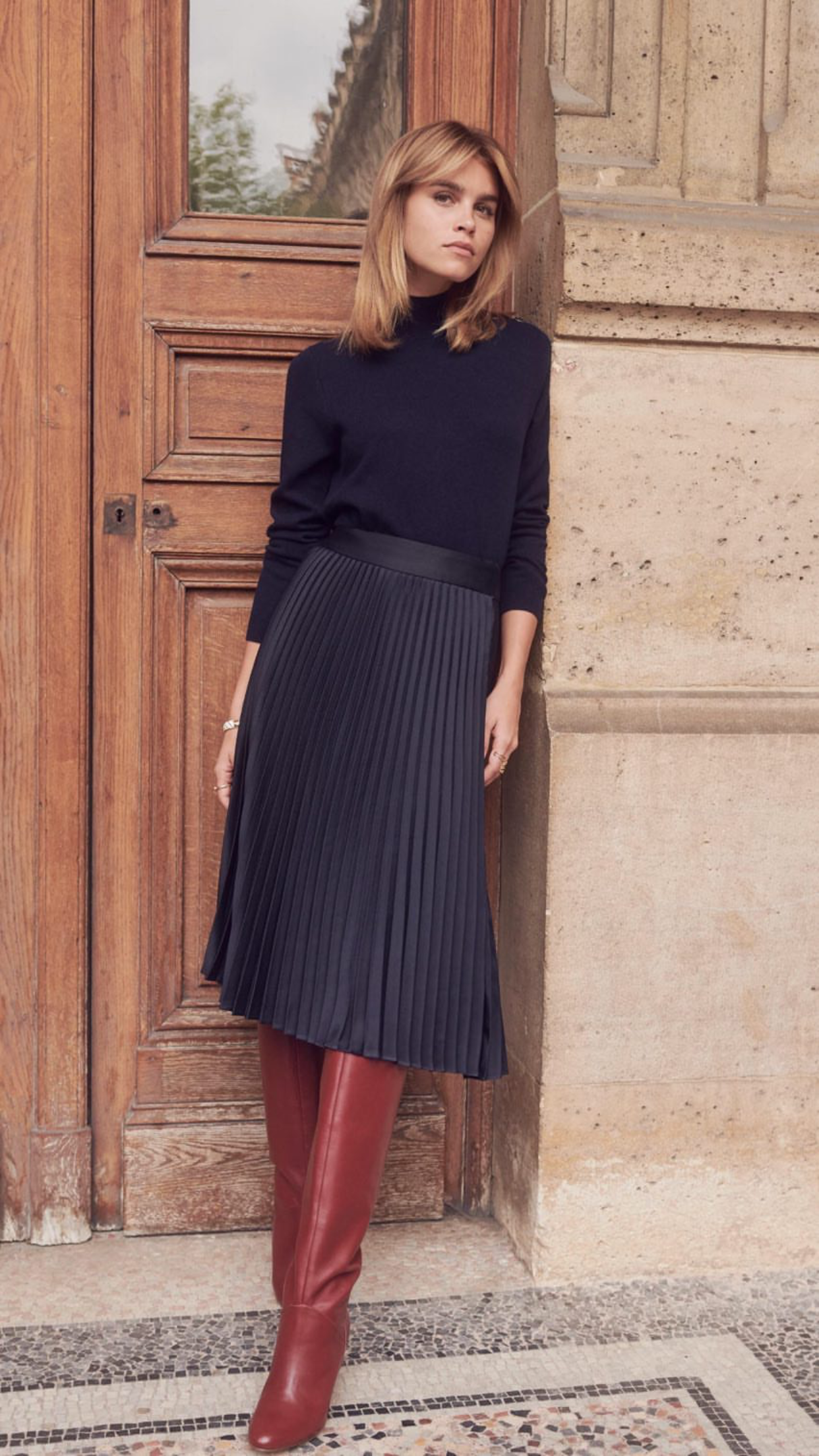 40d489e42744 Black sweater, navy pleated midi skirt, red boots. Street style, street  fashion