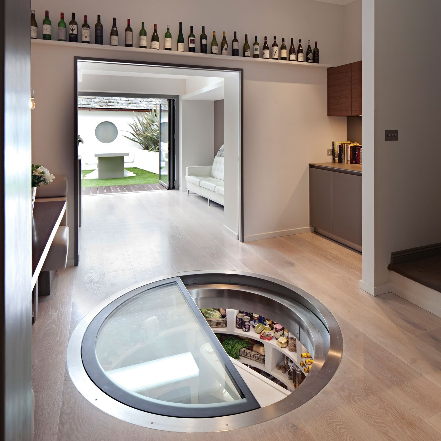 Larder whit spiral staircase with retractable round trap for Spiral wine cellar cost