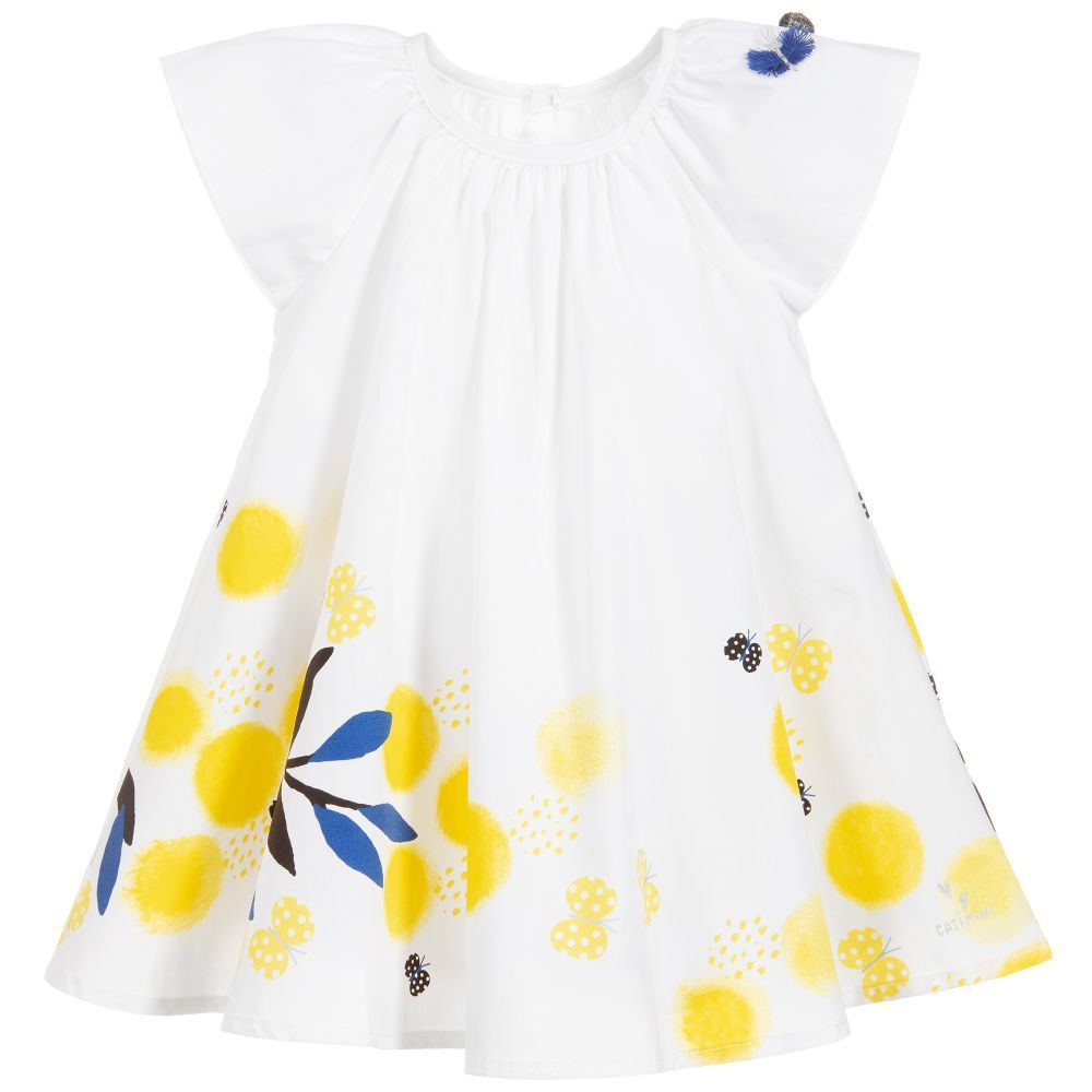 4d5ff6cb Younger girls white dress from Catimini, with a yellow, black and blue  floral print and butterfly appliqué on the shoulder. Made in soft cotton,  ...