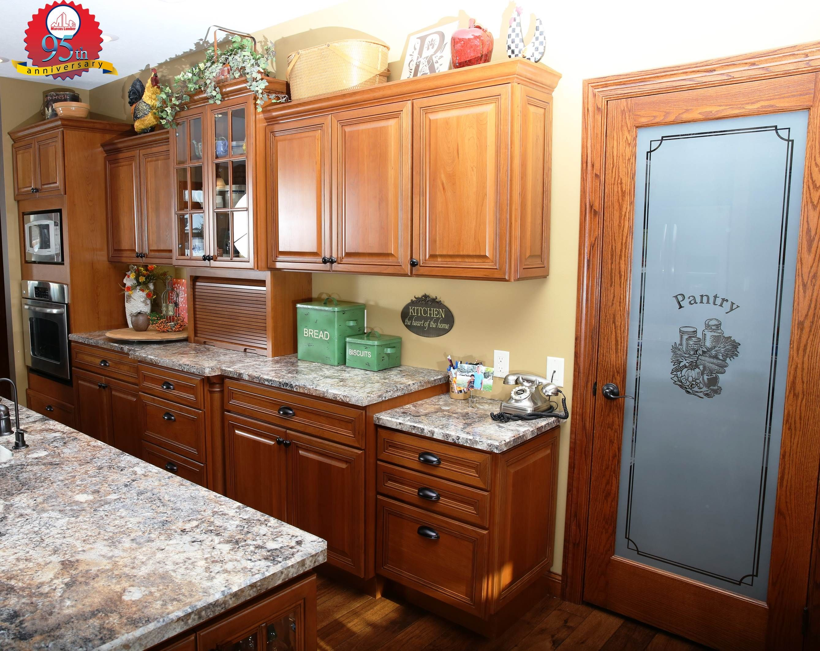 These antique mascarello bevel edge top countertops pliment the