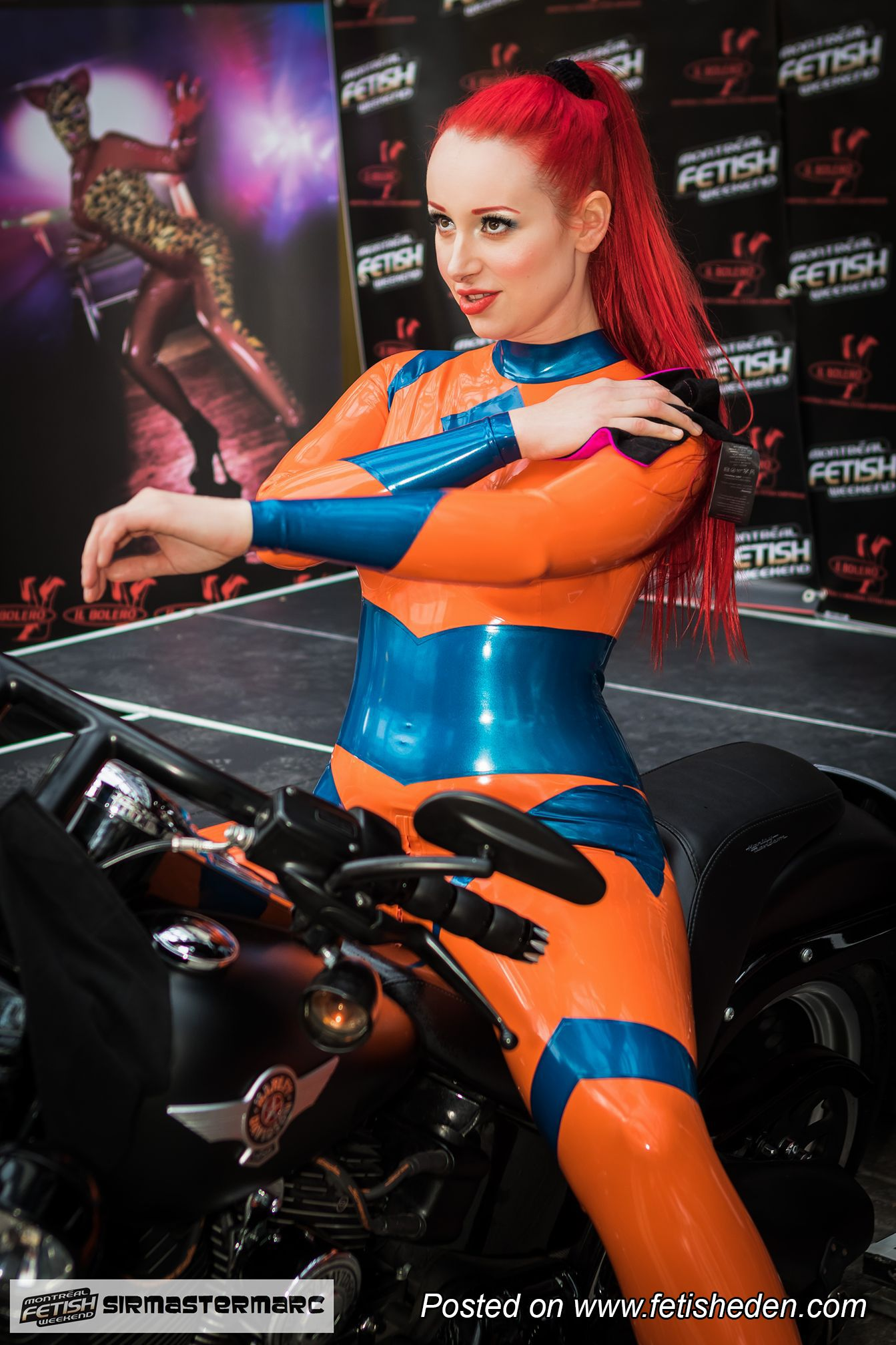 79aebc8fb Redhead Miss Fetilicious knows both how to be sexy in orange latex ...