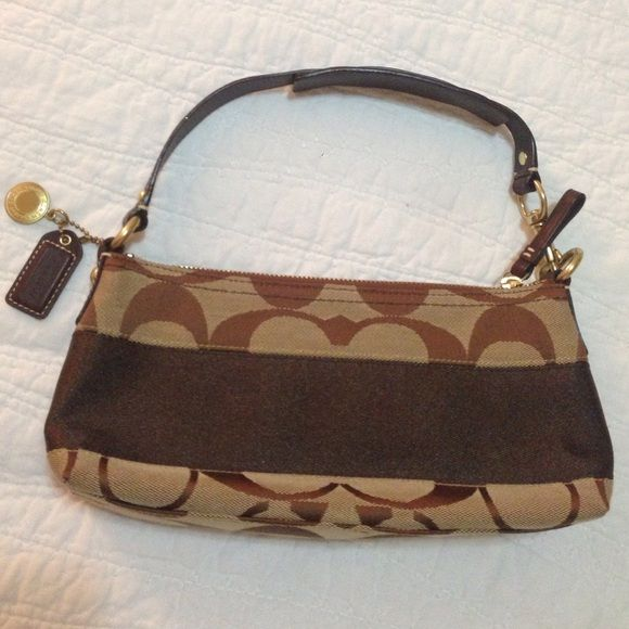 ‼️ $1.99 shipping! PRICE DROP! Coach Purse. NWOT ‼️ $1.99 shipping! PRICE HAS BEEN DROPPED! Only for today! Price firm unless bundled. NEVER USED! Brand new, signature stripe khaki and brown Coach purse. Measures 10.5 inches x 5 inches. Coach Bags Mini Bags
