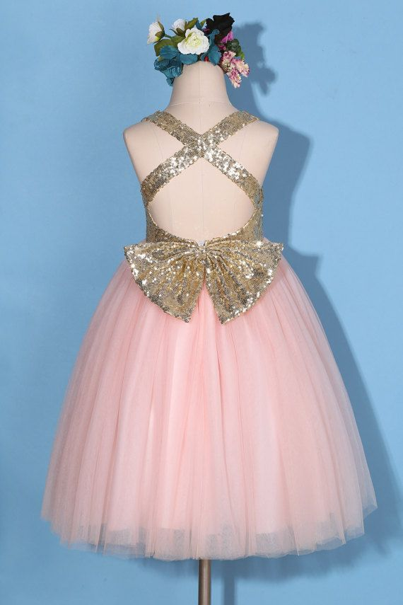 f3bb3f06ad This beautiful gold pink princess flower girl dress features light gold  sequin top