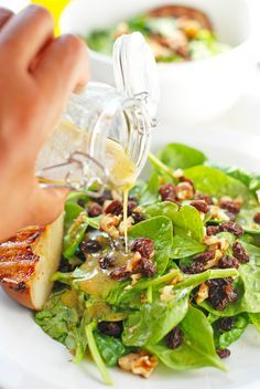 You need to try this delicious Spinach & Pear Salad with Dijon Mustard Vinaigrette