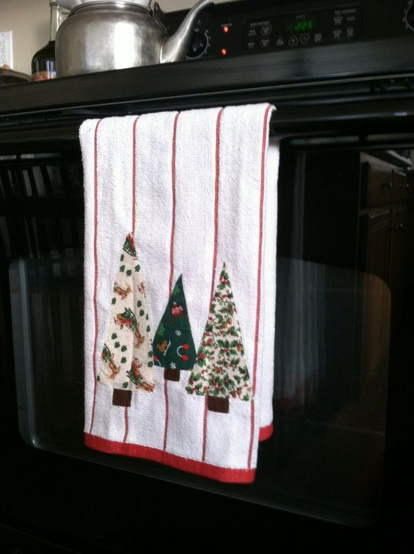 Christmas tree appliqued tea towels.  Easy to make trees from holiday prints  and machine applique on store bought kitchen towels!