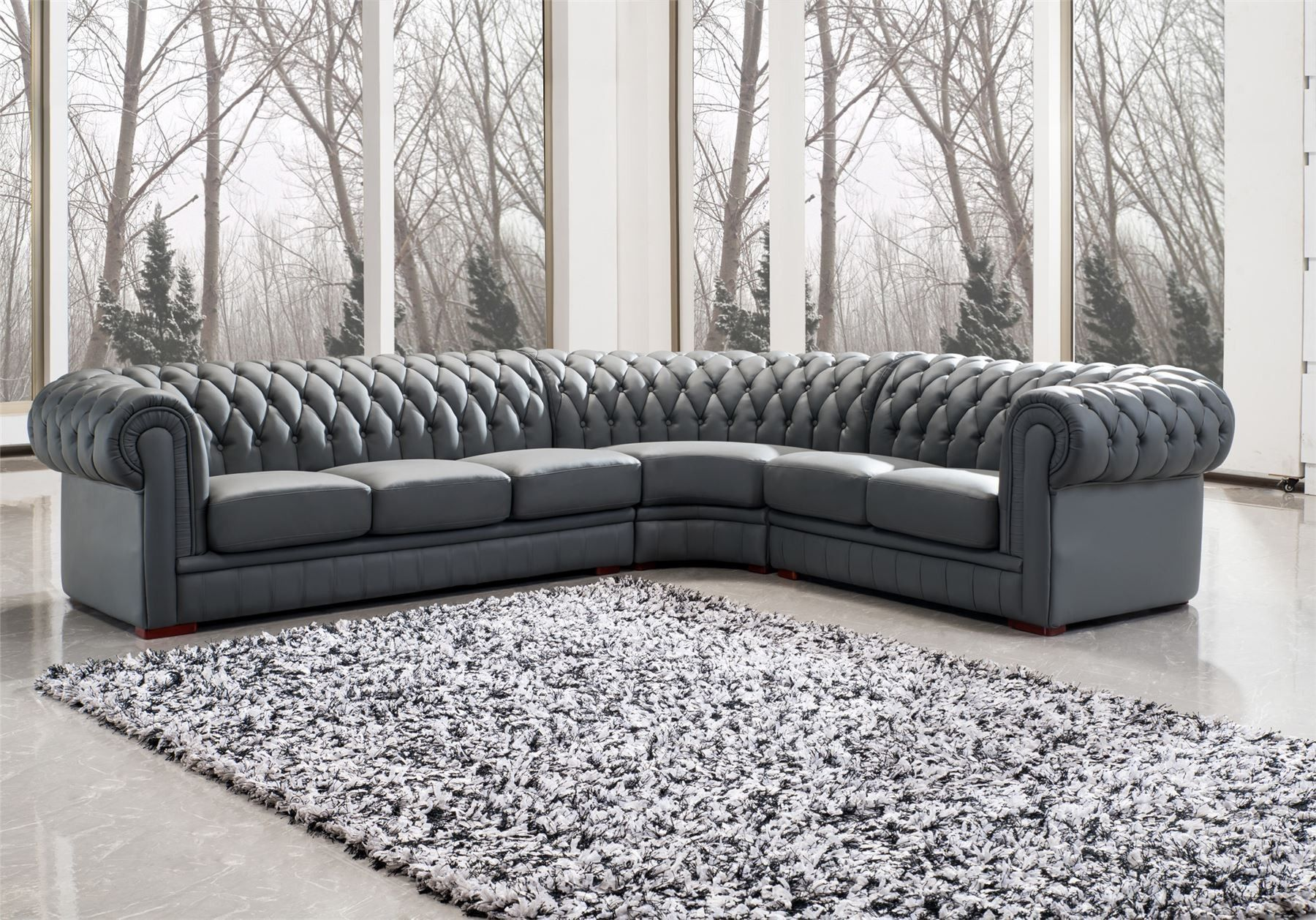 grey upholstered sectional leather chesterfield sofa in corner living