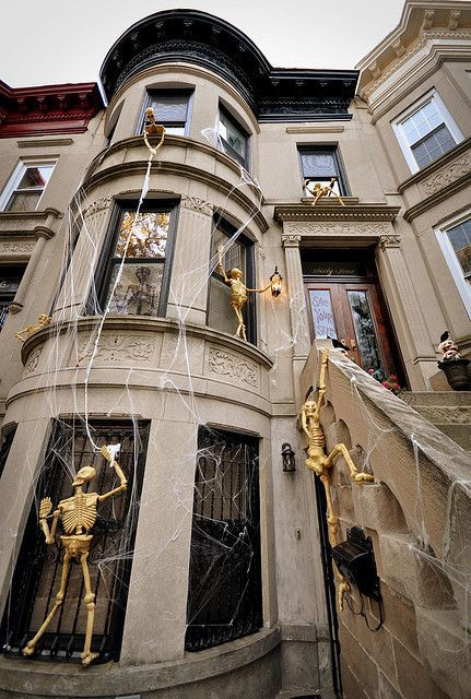 SkeletonsClimbingonHouse1 The Skeleton in the Closet! Pinterest - halloween decoration themes