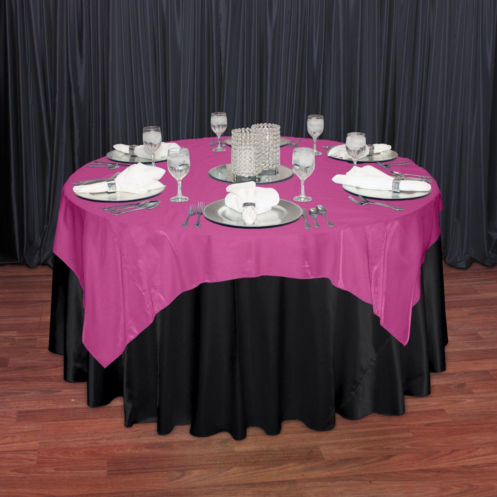 Beyond Elegance: Fuchsia Organza Satin Overlay Over A Black Satin Polyester  Tablecloth