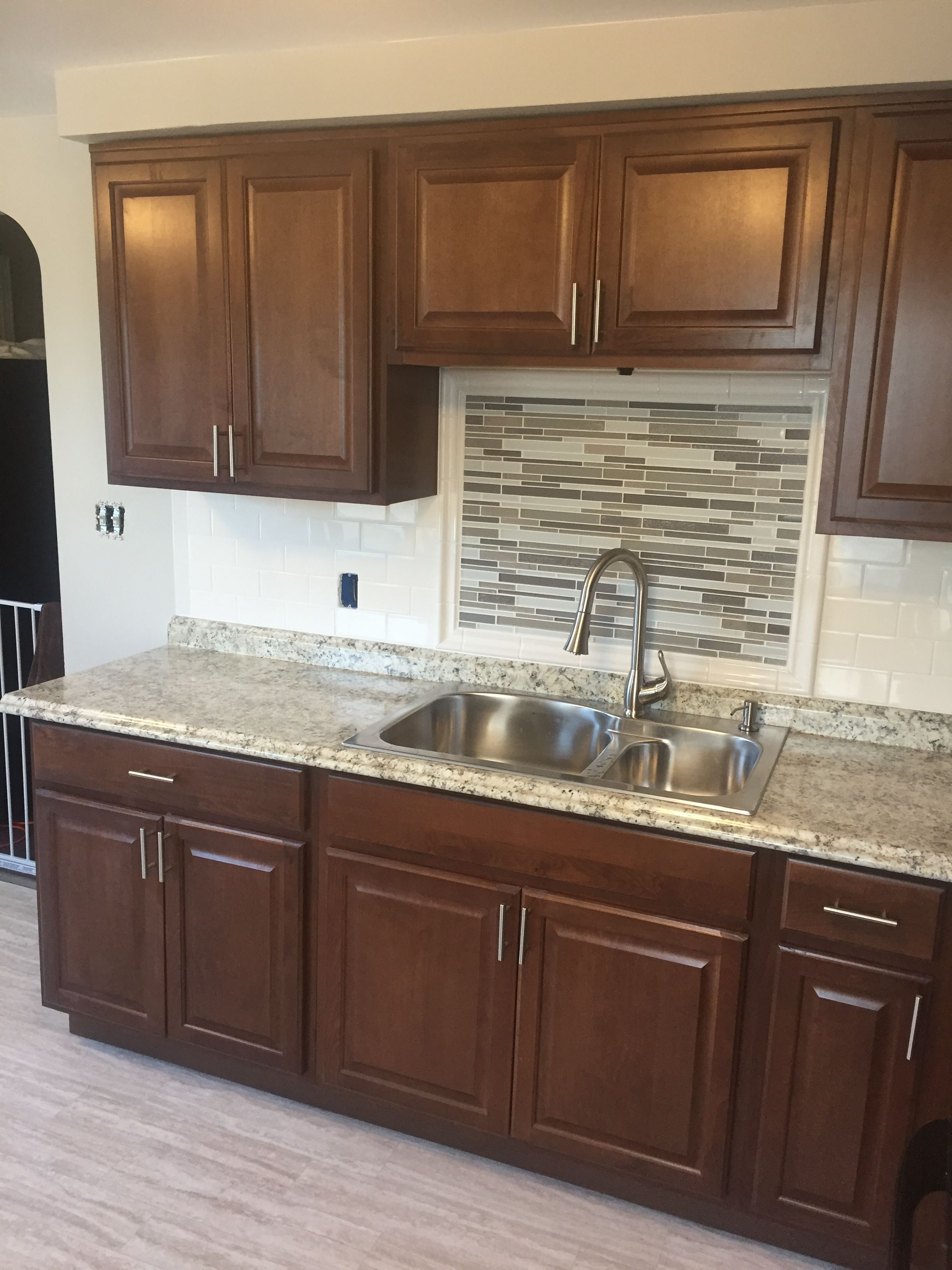 Hampton Bay cognac kitchen cabinets with subway tile backsplash and ...