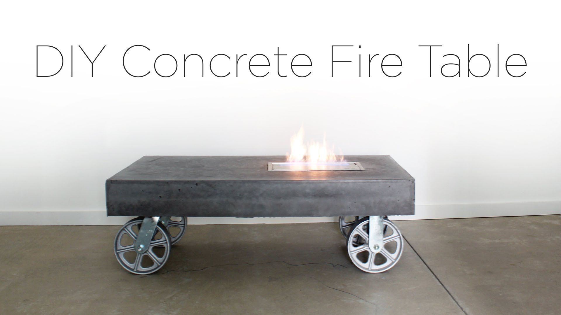 this diy concrete coffee table has a built in ethanol fireplace