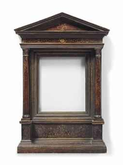 AN ITALIAN WALNUT AND PARCEL-GILT TABERNACLE FRAME 19TH CENTURY The entablature and two supporting columns with trailing gilt leaf scrolls, the moulded inner frame with egg and dart gilt border