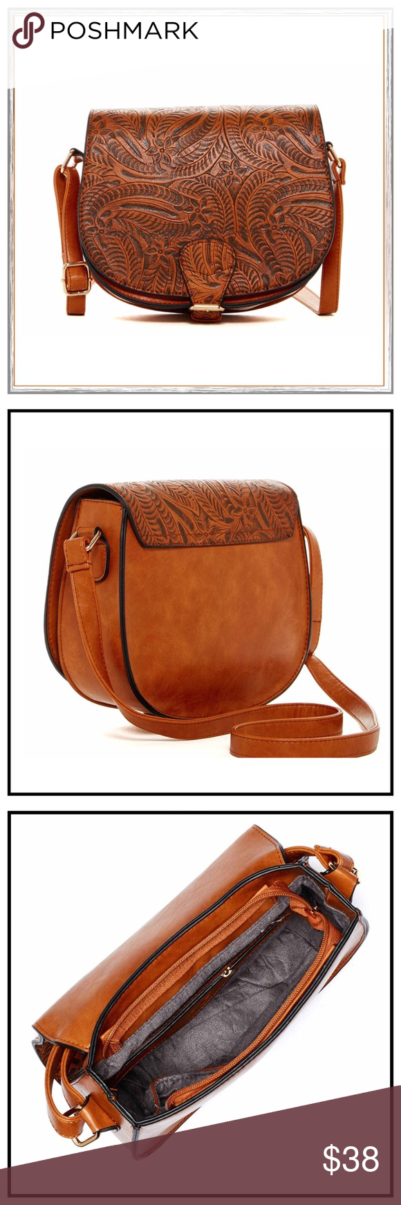 """✨Tooled Saddle Cross Body Bag✨ Rich, Textured Floral Print Composes A Classic Western-Inspired Saddle Cross Body Featuring A Spacious Interior For Everyday Use✨Fold Over Flap With Buckle Detail And Magnetic Closure✨Adjustable Shoulder Strap Strap✨Top Zip Closure✨Interior Has 1 Zip Pocket And 2 Media Pockets✨Approx 8""""H X 9""""W X 3.25""""D✨Approx 10-20"""" Strap Drop✨Polyurethane Exterior And Fabric Interior Lining✨NWT✨Color is Cognac✨ Nu-G Bags Crossbody Bags"""