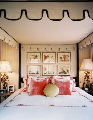 Canopy bed with awning top, coral velvet pillows, framed botanicals, whimsical bedside lamps - Celerie Kemble