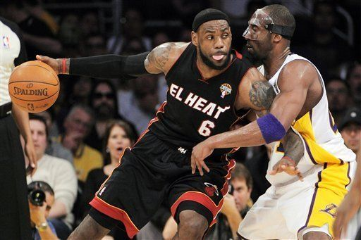Miami Heat Forward Lebron James 6 Backs Down On Los Angeles Lakers Guard Kobe Bryant During The First Half Of Their Miami Heat Nba Finals Los Angeles Lakers