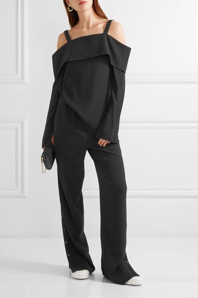 Black crepe Pull on 71% triacetate, 29% polyester Dry clean Imported