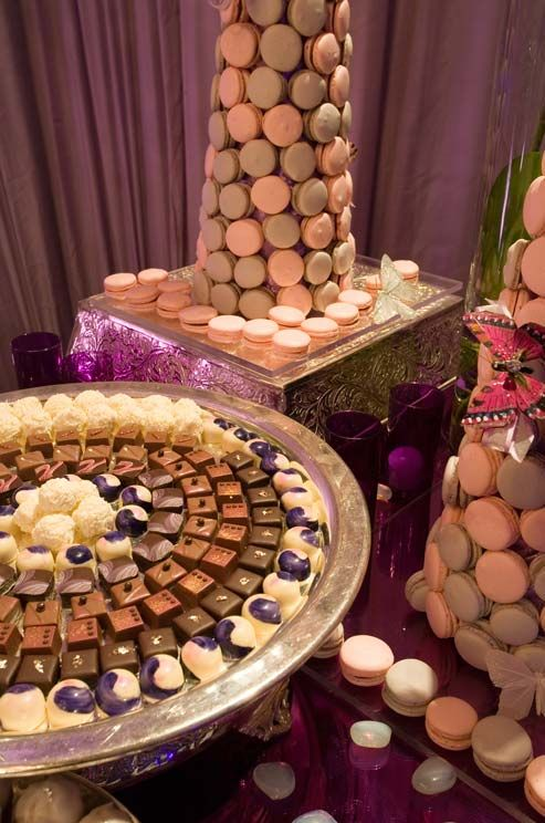 A Platter Of Petit Fours And Towers Of Pink And Purple Macarons With Butterfly Decorations Tempted Wedding Dessert Table Dessert Buffet Table Wedding Desserts
